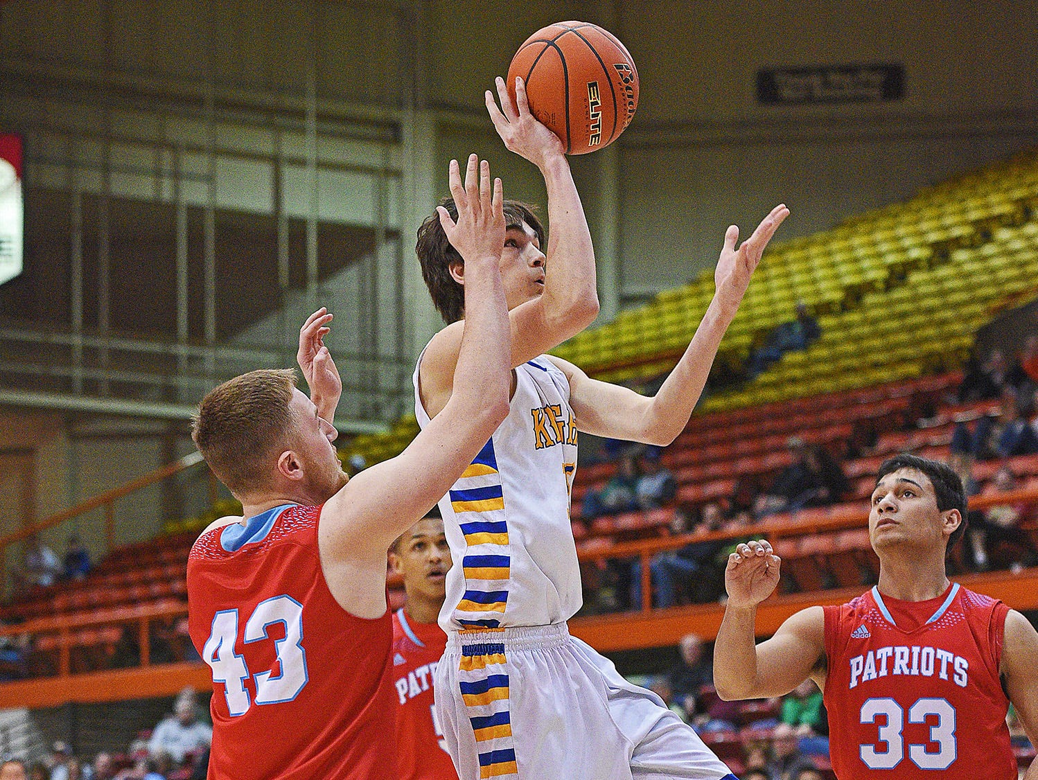 O'Gorman's Joey Messler (15) goes up for a shot over Lincoln's Andrew Tverberg (43) during a 2017 SDHSAA Class AA State Boys Basketball semifinal game Friday, March 17, 2017, at Rushmore Plaza Civic Center in Rapid City.
