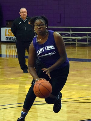 Jada Swafford practices with the rest of the University Academy girls' basketball team.