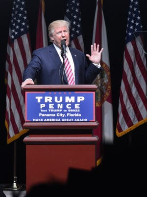 Republican presidential nominee Donald Trump on stage at a rally in Panama City Beach on Oct. 11.