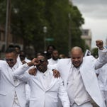Pallbearers lead a march down Selby Avenue after the funeral of Philando Castile at the Cathedral of St. Paul in St. Paul, Minnesota. Castile was shot and killed on July 6 by police in Falcon Heights, Minnesota.