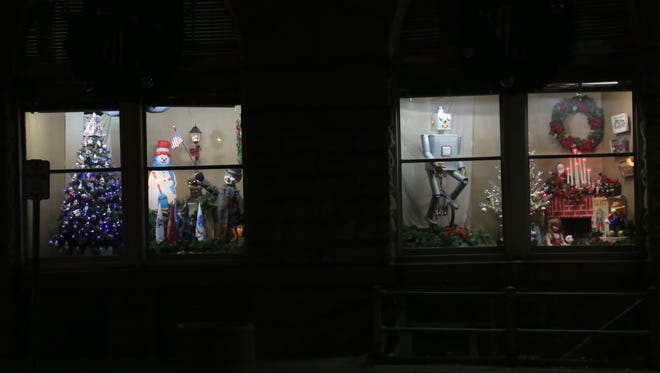 The windows of the Mansfield Memorial Museum are decorated into a Christmas theme thanks to the efforts of curator Scott Schaut.