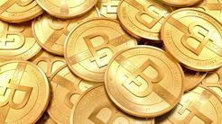 Heap of gold coins with Bitcoin logo.