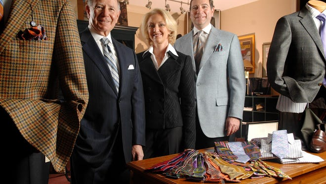 Going from left, Don Rhoda, his wife, Pamela, and his son Edward dress the part in their apparel store.