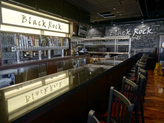 The bar area features 32 different beers on tap.
