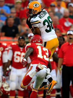 Packers cornerback Tramon Williams intercepts a pass intended for Chiefs wide receiver A.J. Jenkins during last year's preseason game.