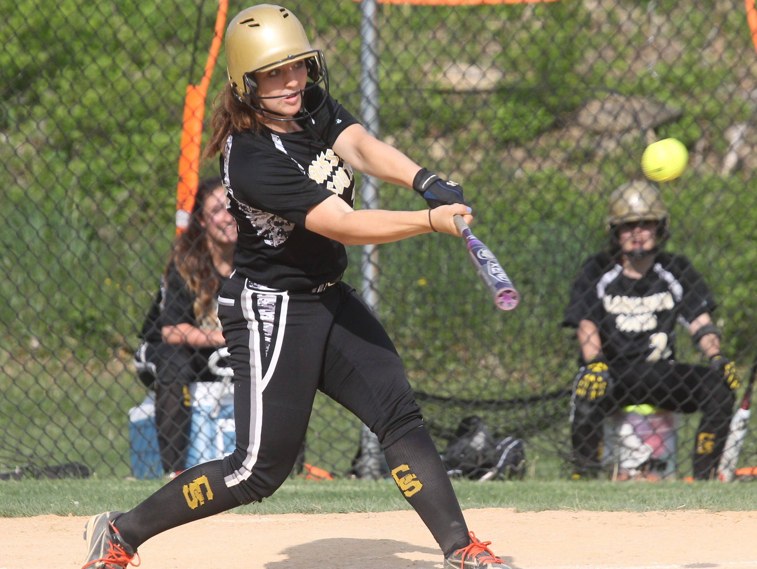 Clarkstown South's Sara Herskowitz hits a home run at Hendrick Hudson May 11, 2015. Clarkstown South won 11-4.
