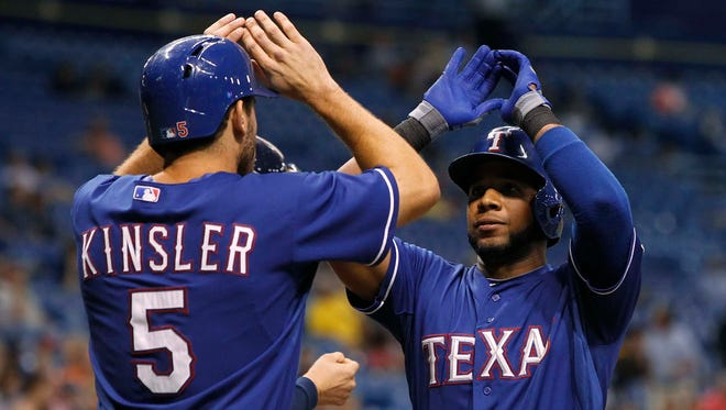 Ian Kinsler, left, and Elvis Andrus homered and drove in three runs each