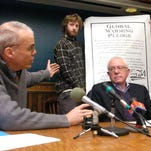 Author Bill McKibben (left) and Sen. Bernie Sanders, I-Vt., speak at a news conference in Burlington on Jan. 15, 2007, while Will Bates and Kim Locke (right) hold up a global warming pledge signed by Sanders and several other Vermont politicians. McKibben will be speaking at Sanders' presidential campaign kickoff in Burlington on Tuesday.