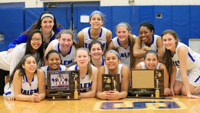 The smiles say it all as Salem's varsity girls basketball team soaks it all in after winning the KLAA championship Thursday night.
