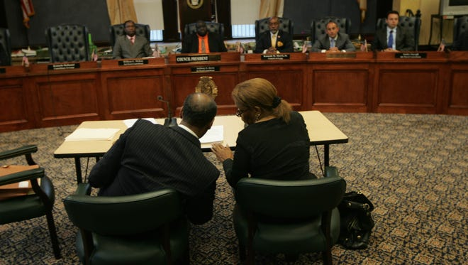 Betty Taylor (foreground, left), Director, Division of Personnel, sits in front of Paterson City Council beside her attorney, Neal Brunson, for a June 2012 disciplinary hearing regarding the Hurricane Irene overtime scandal.