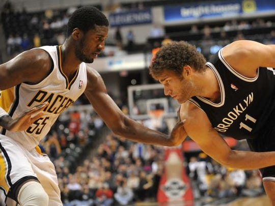 Indiana's Roy Hibbert tries to ply tight defense on Brooklyn's Brook Lopez in the fourth quarter, but the Brooklyn Nets beat the Indiana Pacers 89-84 in overtime at Bankers Life Fieldhouse Monday February 11, 2013.