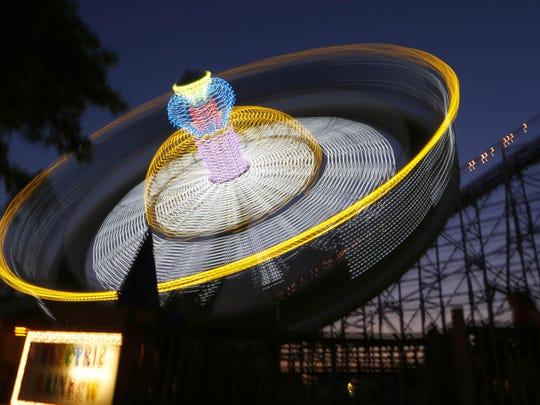 People ride the Electric Rainbow ride during Hamilton County 4-H Community Fair at Stricker's Grove.