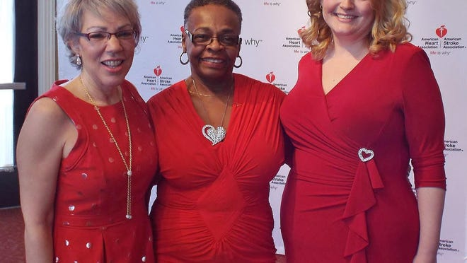 Linda Thomas, center, was voted by the BetterU Challenge participants as the program's spirt award winner, earning her a free year-long membership at Golds' Gym. Karen Shan, left, and Renee Osterhoudt also are pictured.