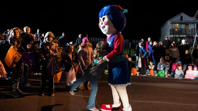 A child gives the Utz girl a hug during the Hanover Halloween Parade on Oct. 26, 2017.