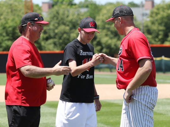 Ben Lepisto, center, is greeted by Woodbridge baseball coach Lou Urbano, left, and Harry Rutkowski (14) at the 2016 GMC Underclassmen Baseball Showcase.