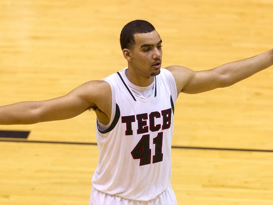 Tech High School senior Trey Lyles (41) guards for