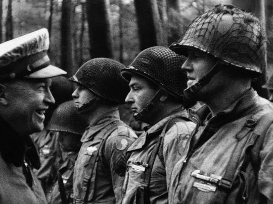 Gen. Dwight D. Eisenhower, Supreme Allied Commander, talks with men of the American Divison on D-Day, June 6,1944.