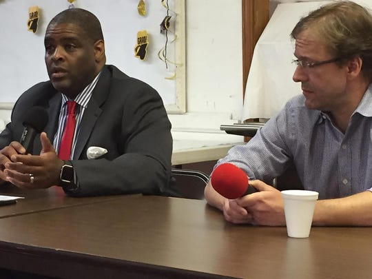 Demond Means (left) and County Executive Chris Abele discuss their plans for implementing the Opportunity Schools Partnership Program in Milwaukee.