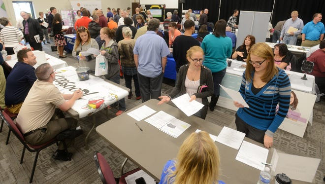 Job seekers and employee seekers gathered at the Zanesville Welcome Center for a job fair on Thursday.