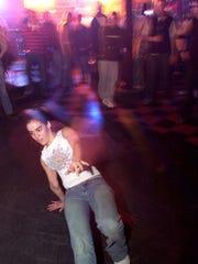 Miranda Millard of Hamilton break dances at Top Cats Wednesday, March 12, 2003.