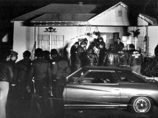 Jan 13, 1983   Memphis Police gather around the house at 2239 Shannon following the assault in the early morning hours.