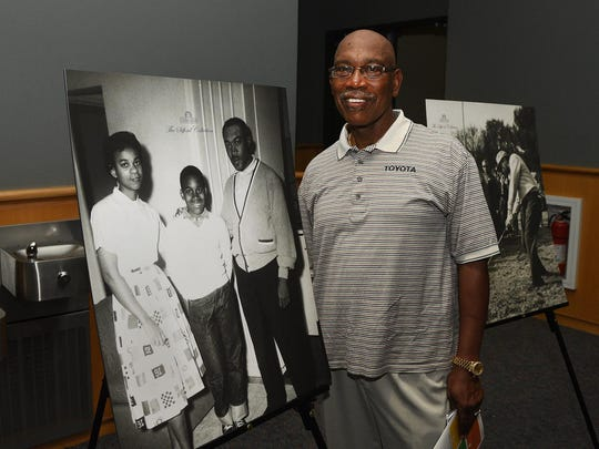 Charles Sifford Jr. is shown at UMES with photos of