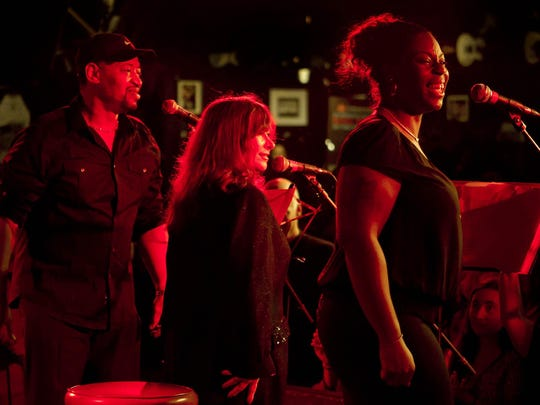 Michelle Moore (right) performs with the Alliance Singers