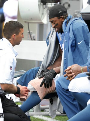 Indianapolis Colts wide receiver T.Y. Hilton (13) sits on the bench with his knee wrapped up in the second half of the game Sunday, September 13, 2015 at Ralph Wilson Stadium in Orchard Park NY. The Colts lost 27-14.