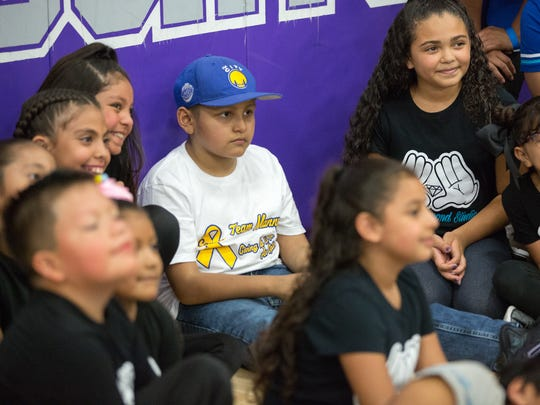 Manny Lopez , 8, who suffers from osteosarcoma, has his pictured taken on Saturday, August 19, 2017, with members of Daring Diamond Studio hiphop dancers during Team Manny's Hoops for Hope fundraiser at Camino Real Middle School. During the event LCPD's basketball played against Amputee Basketball Invigorated.