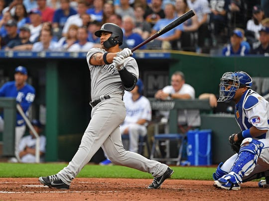 New York Yankees second baseman Gleyber Torres hits a three-run home run during the fourth inning against the Kansas City Royals at Kauffman Stadium on May 19, 2018.