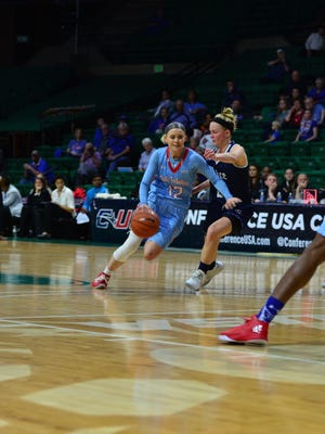 Louisiana Tech guard Brooke Pumroy drives to the basket in Wednesday's second-round game against Rice.