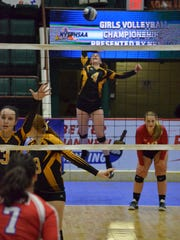 Grace Chlebove (4) on the attack for Honeoye Falls-Lima in the girls volleyball state championship match on Sunday.