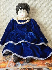 Earline Hughes' doll collection includes some her mother hand painted and dressed.