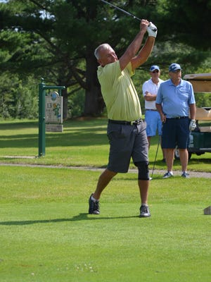 Defending champ Mike LeBarre hits off the tee during the first day of the City Senior Golf Tournament at Cedar Creek Golf Club on Monday.