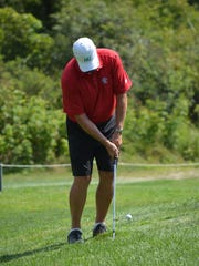 Mike Tungate chips up to the green during the second