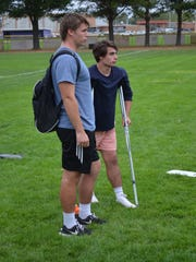 Lakeview standout Steven Laws, left, watches from the sidelines after suffering a season-ending knee injury. He is joined by his brother Blake Laws, who is also injured.
