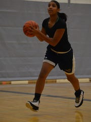 Battle Creek Central's Arieonna Ware leads the Bearcats