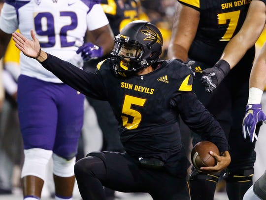 Arizona State quarterback Manny Wilkins (5) signals a first down against Washington during the first half of an NCAA college football game, Saturday, Oct. 14, 2017, in Tempe, Ariz.