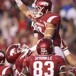Arkansas wide receiver Drew Morgan (80) celebrates after a touchdown against Texas Tech.