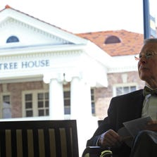 Aubrey Lucas, former University of Southern Mississippi president, sits in view of the restored Ogletree House during it grand reopening recently. Lucas will speak about the history of the university at noon Friday at the Peck House, 3601 Pearl St.
