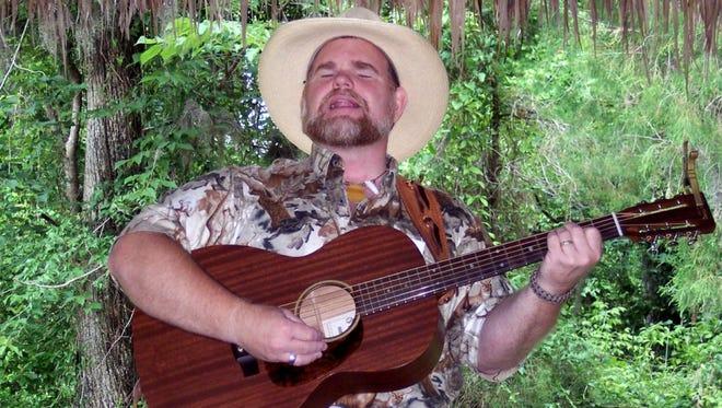 Benjamin Dehart performing his original songs of Florida cowboy culture at the Florida Folk Festival in White Springs.