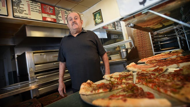 Pete Martorana, the owner of Pete's Pizza, stands inside the pizza shop he opened 40 years ago at 1121 Quentin Road in Lebanon when there was only one other shop in town.