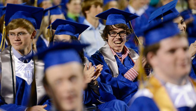 Jason Hickman smiles during graduation Friday evening at Mountain Home High School.