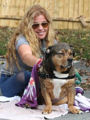 Volunteer Aby Garcia of New City gives Ace a bath at