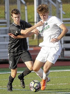 Midfielder Lucas Sarver (right), who was named second-team all-league last season, is among 14 seniors for the Coffman boys soccer squad, which fell in a Division I district semifinal last fall.