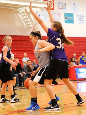 Lakewood's Sydney Houdeshell attempts to make a post move around Bloom-Carroll defender Haley Vollmer during a scrimmage on Wednesday.