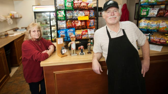 Steve Wright and Barbara Klenk operate BNE Subs in downtown Wilmington. Wright has been making lunches for DuPont Co. employees for 30 years, and has seen the workforce at the company's corporate headquarters across the street dwindle from 7,000 to as few as 700.