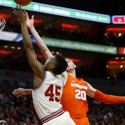 Louisville's Donovan Mitchell drives to the basket