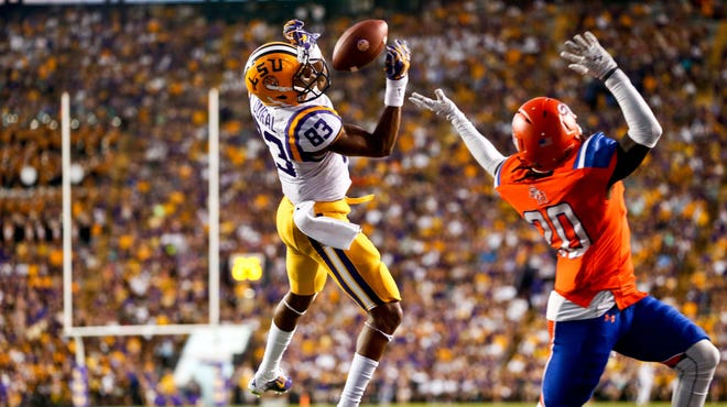 LSU wide receiver Travin Dural, shown catching a touchdown over Sam Houston State, suffered minor injuries in a car accident.
