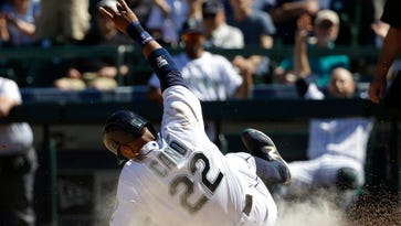 Seattle Mariners' Robinson Cano scores on sacrifice fly hit by Nelson Cruz in the seventh inning of a baseball game against the Tampa Bay Rays, Wednesday, May 11, 2016, in Seattle. (AP Photo/Ted S. Warren)